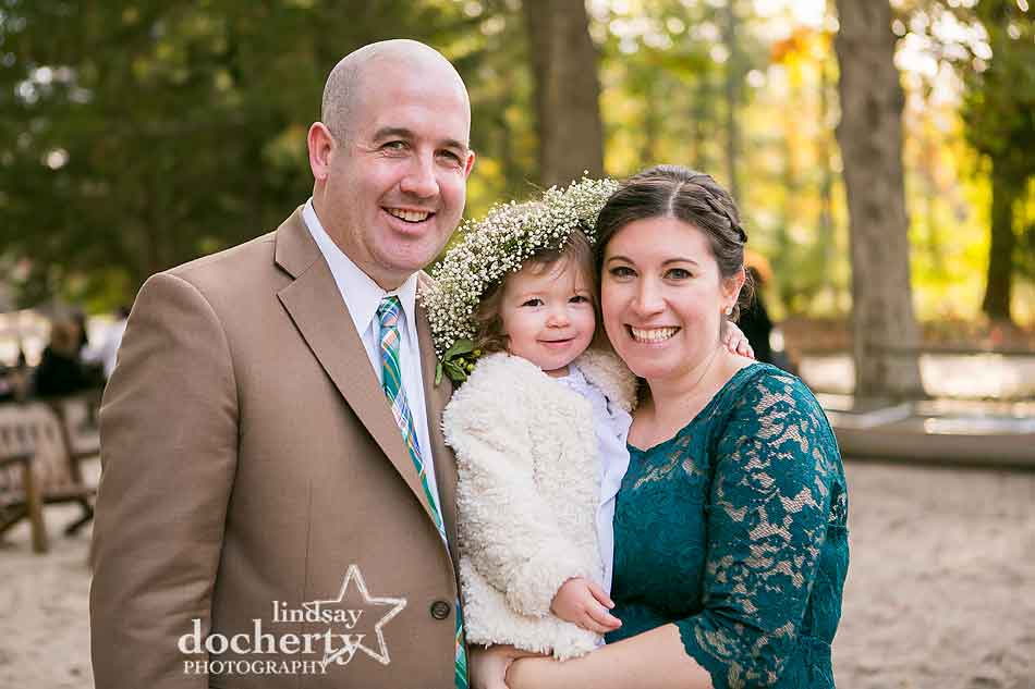 family-picture-with-flower-girl-at-camp-ockanickon-wedding-in-new-jersey