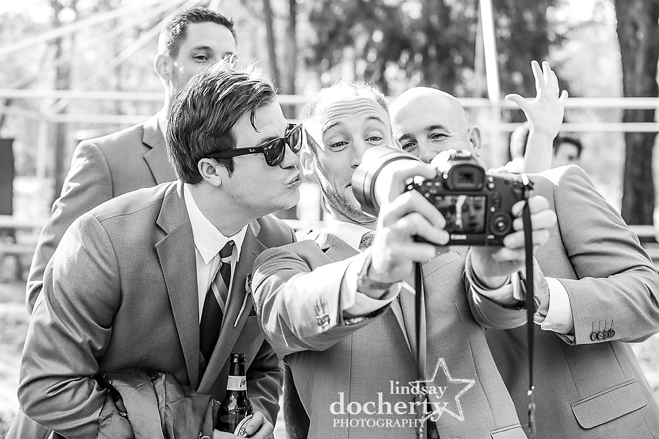 groomsmen-acting-goofy-with-camera-at-camp-ockanickon-wedding-in-new-jersey