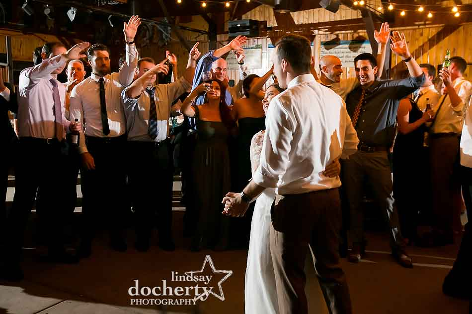 guests-cheering-for-newlywed-couple-on-dancefloor-at-camp-ockanickon-wedding-in-new-jersey