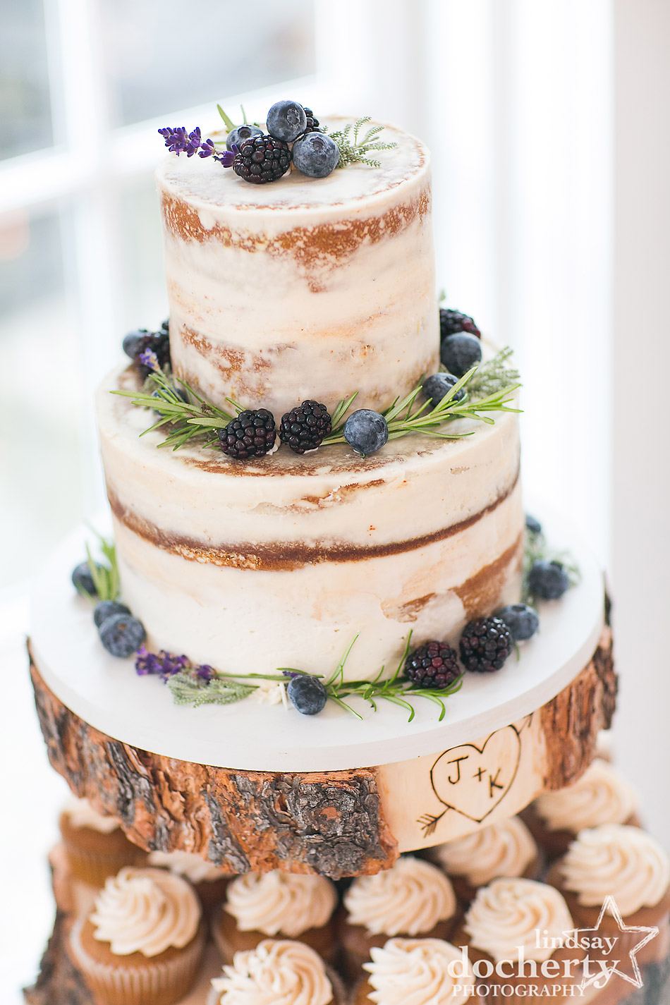 naked wedding cake with blueberries and blackberries