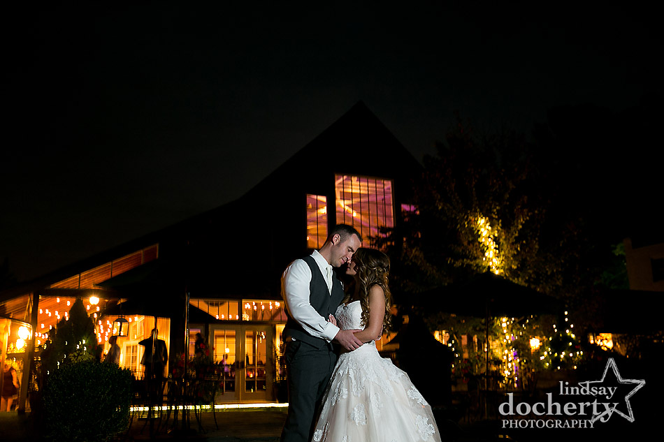 nighttime wedding picture of bride and groom at Riverdale Manor