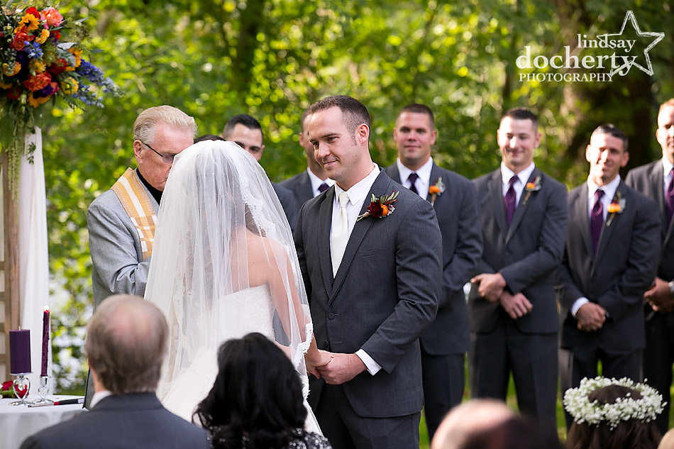 grooms face during outdoor ceremony at Riverdale Manor