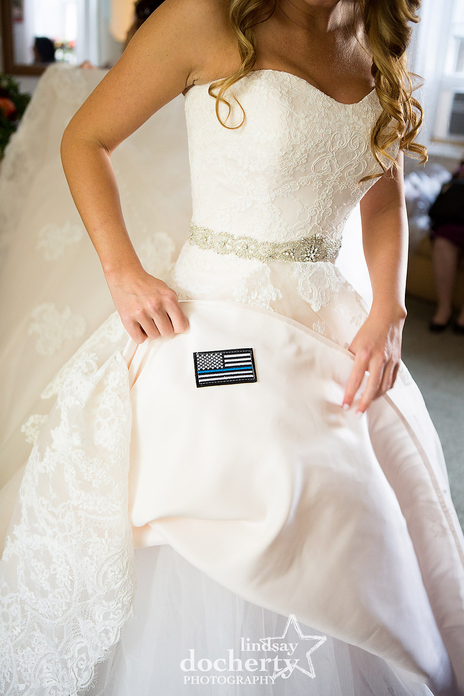 thin blue line police patch under brides wedding dress