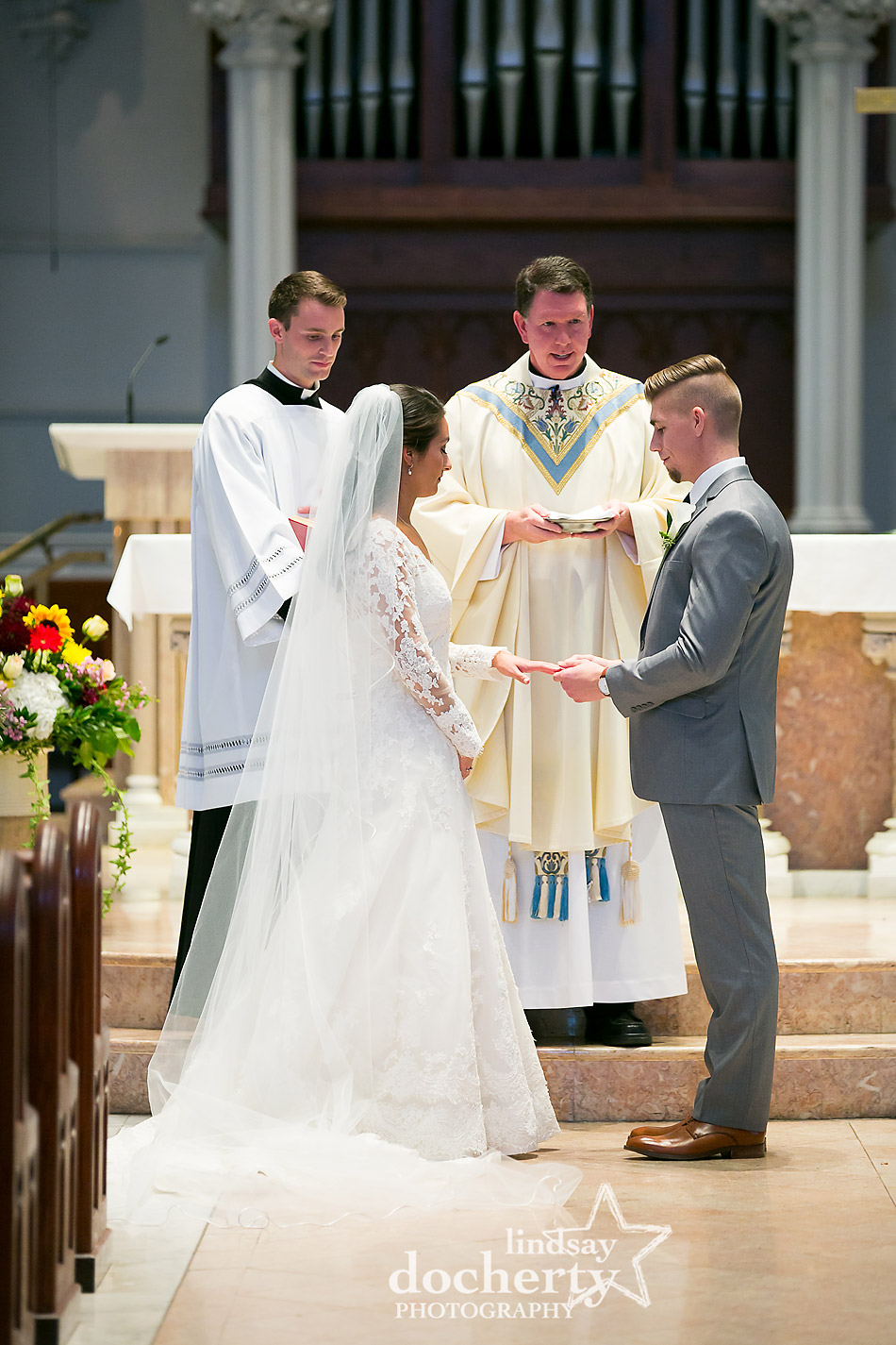 ring exchange at Villanova University Catholic wedding ceremony