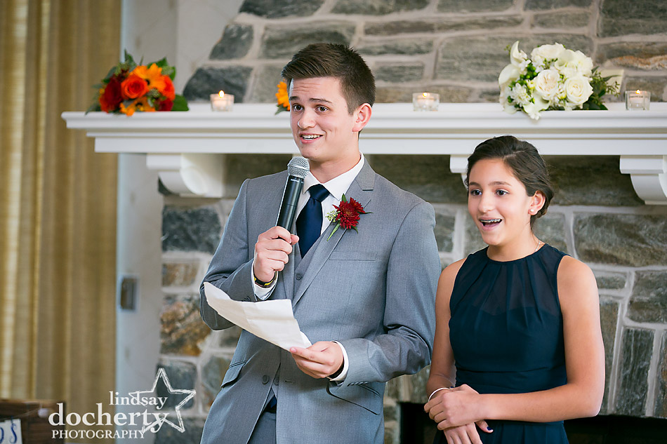 siblings toast bride on wedding day at Llanerch Country Club