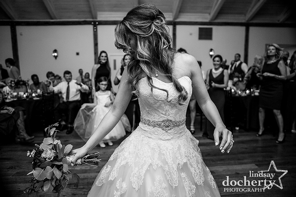 bride tossing the bouquet at Riverdale Manor