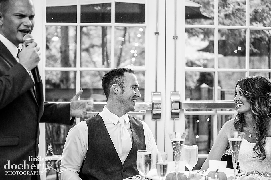 wedding couple laughing during best man toast