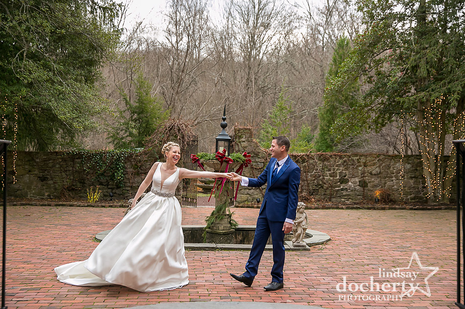 bride and groom dancing on brick terrace at winter wedding at Holly Hedge Estate