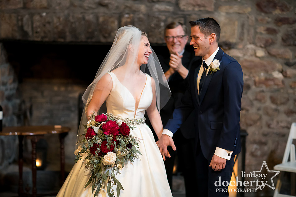 bride and groom end of indoor ceremony at winter wedding at Holly Hedge Estate in New Hope