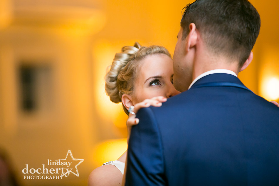 bride looking into grooms eyes during first dance at winter wedding at Holly Hedge Estate in New Hope
