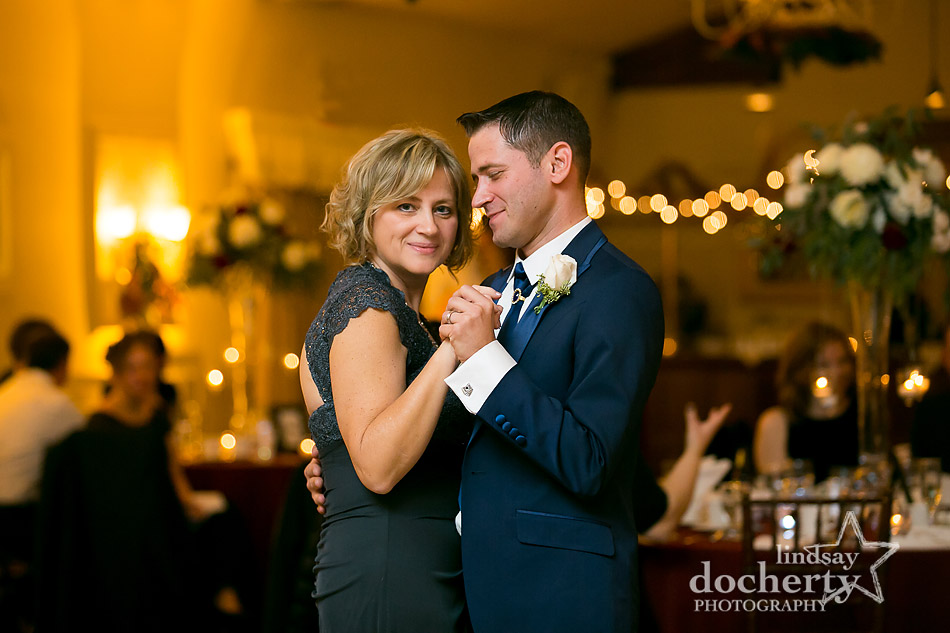 groom and mother dance at reception at winter wedding at Holly Hedge Estate in New Hope