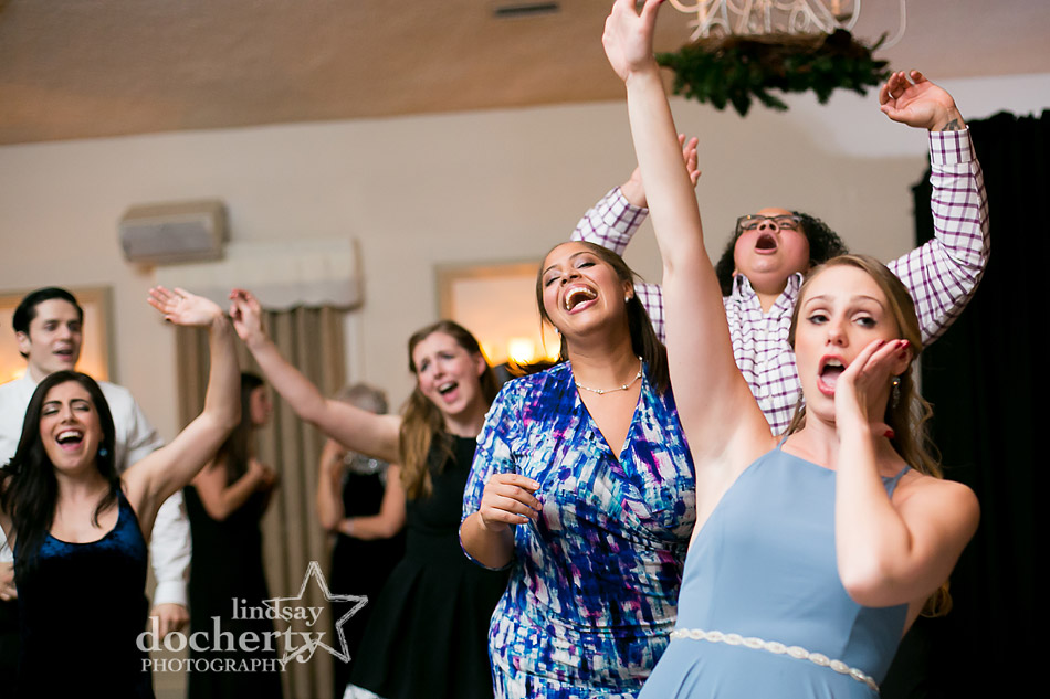 happy dancing at winter wedding at Holly Hedge Estate in New Hope