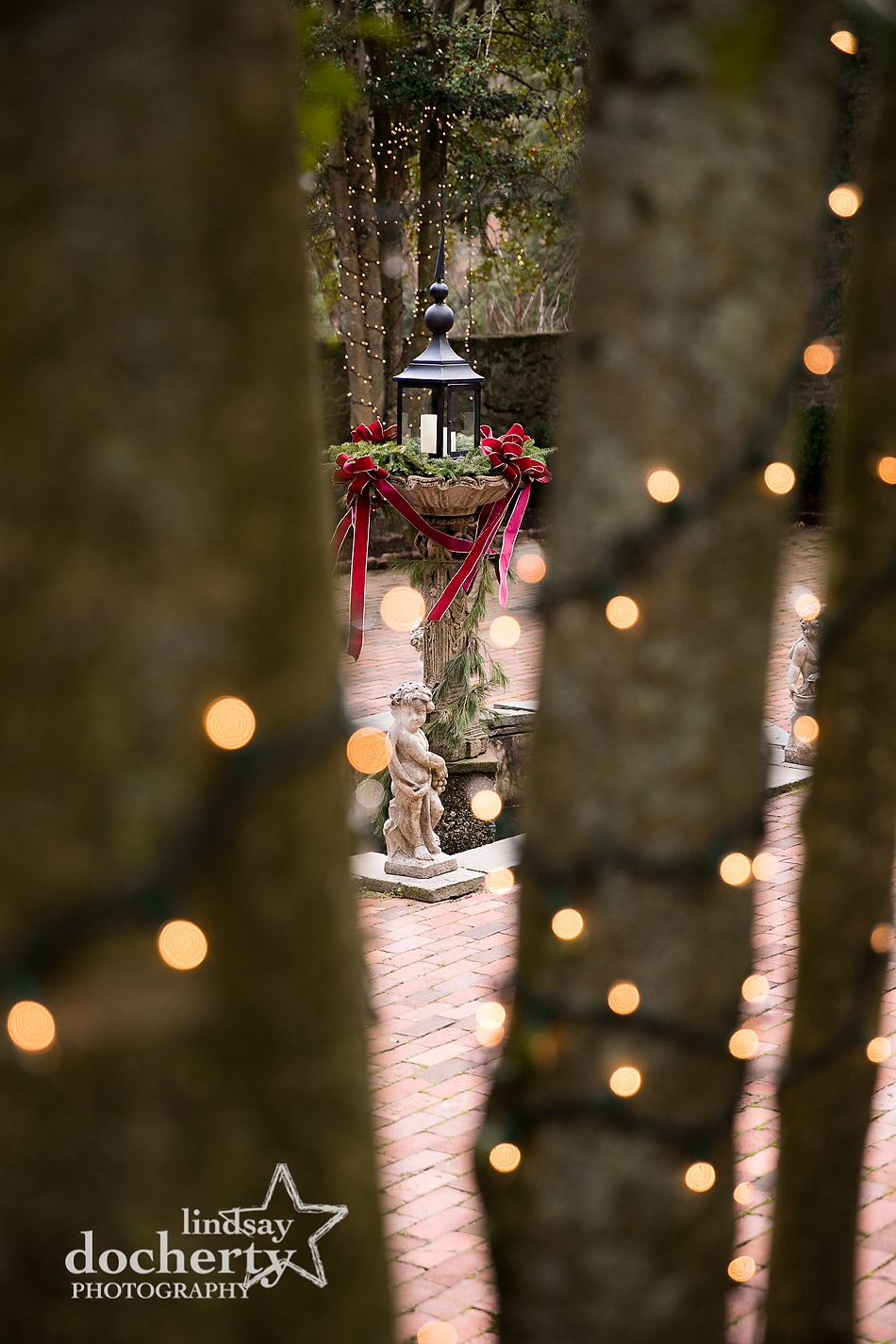 holiday fountain and statue on patio at winter wedding at Holly Hedge Estate in New Hope