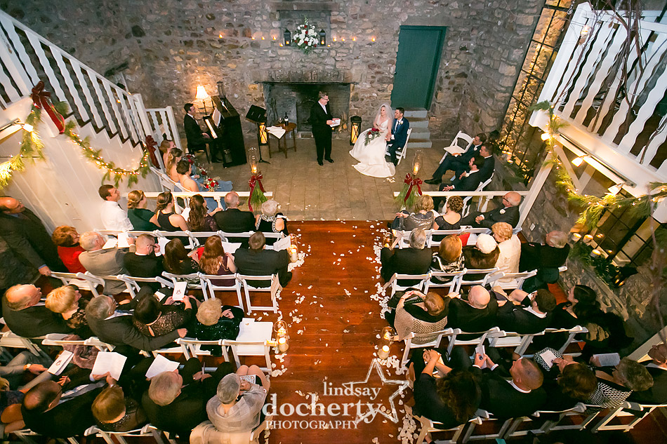 indoor ceremony with patio in Old Barn at winter wedding at Holly Hedge Estate in New Hope