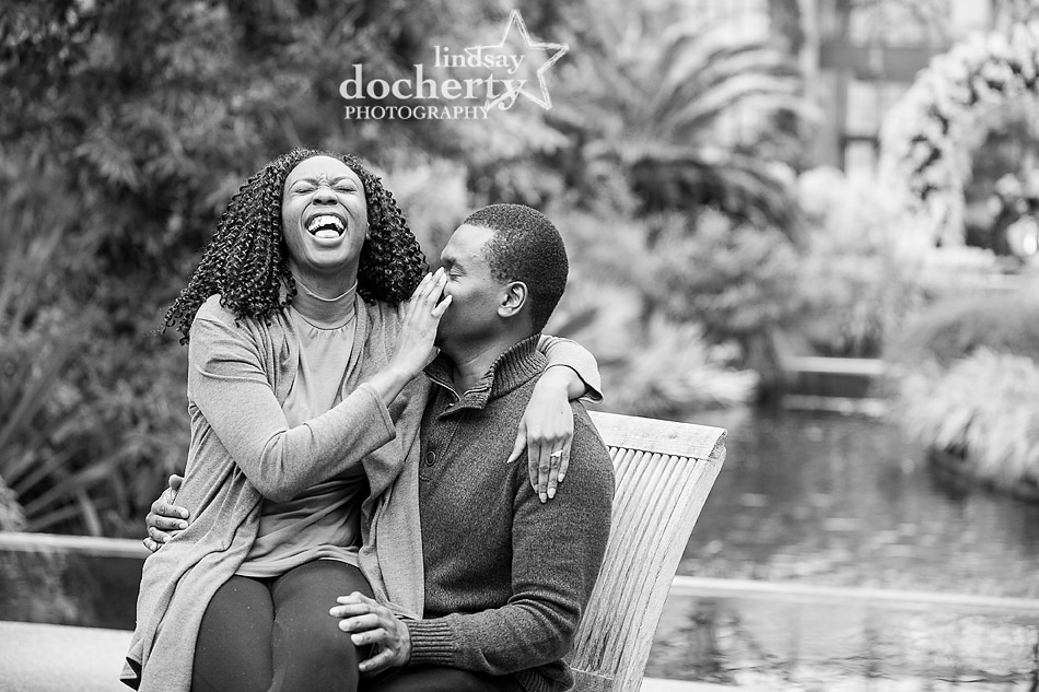 laughing at engagement session at Longwood Gardens