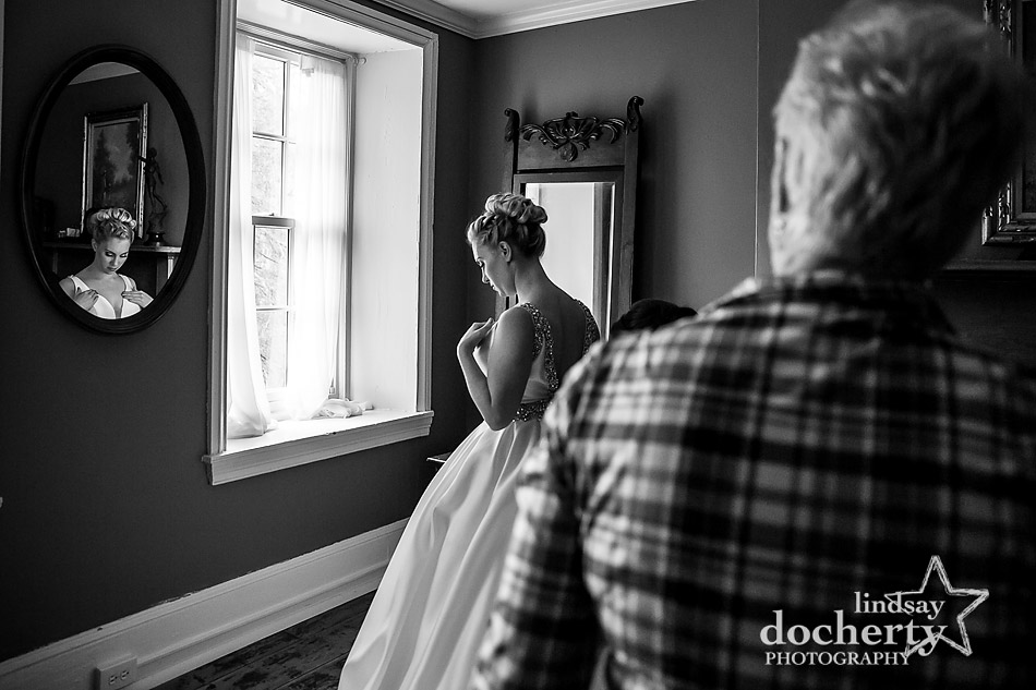mom watching daughter get ready before ceremony at winter wedding at Holly Hedge Estate in New Hope