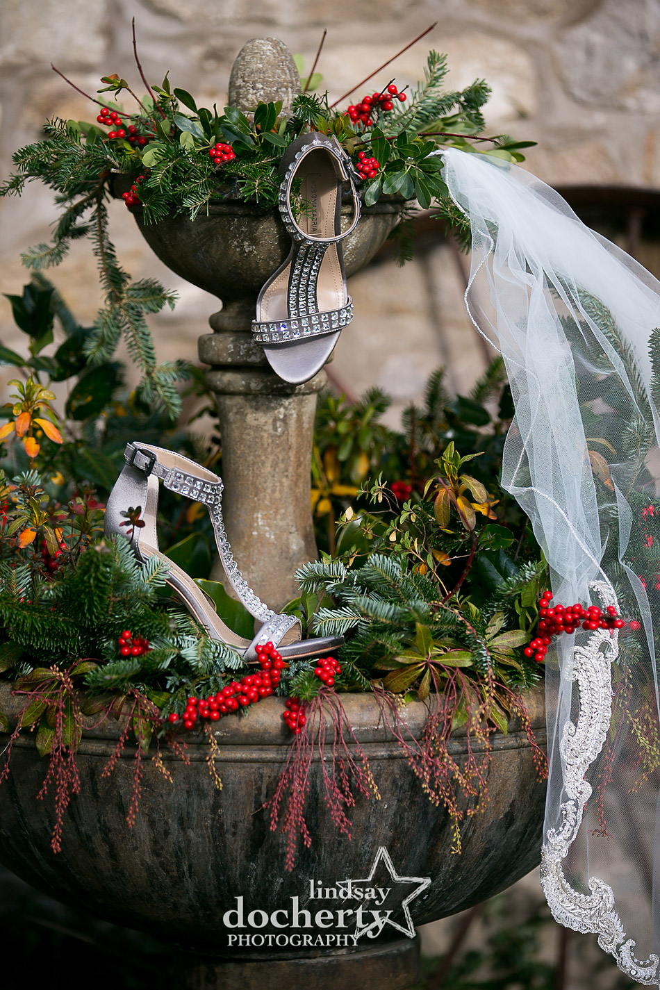 rhinestone bridal heels and veil on holiday greens at winter wedding at Holly Hedge Estate in New Hope