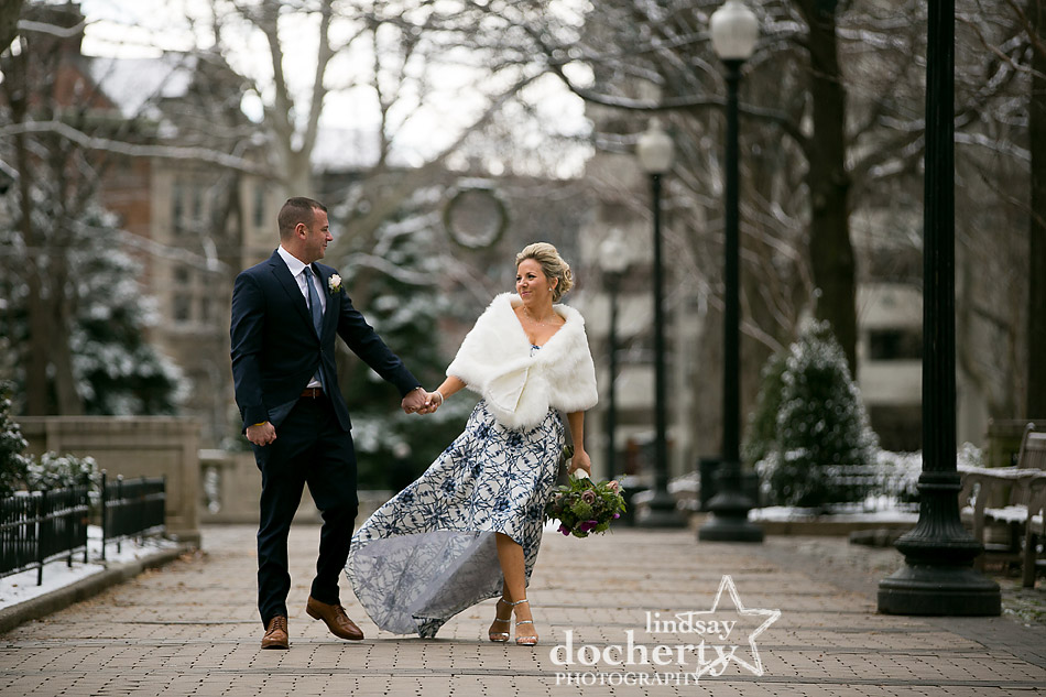 Snowy winter wedding in Philadelphia Rittenhouse Square bride in fur and hi lo blue dress
