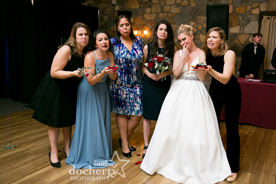 tossing bouquet fail at winter wedding at Holly Hedge Estate in New Hope