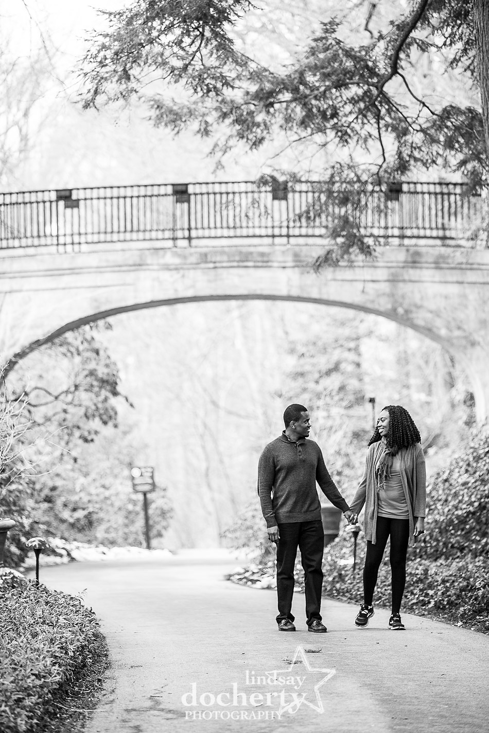 walking outside engagement session at Longwood Gardens