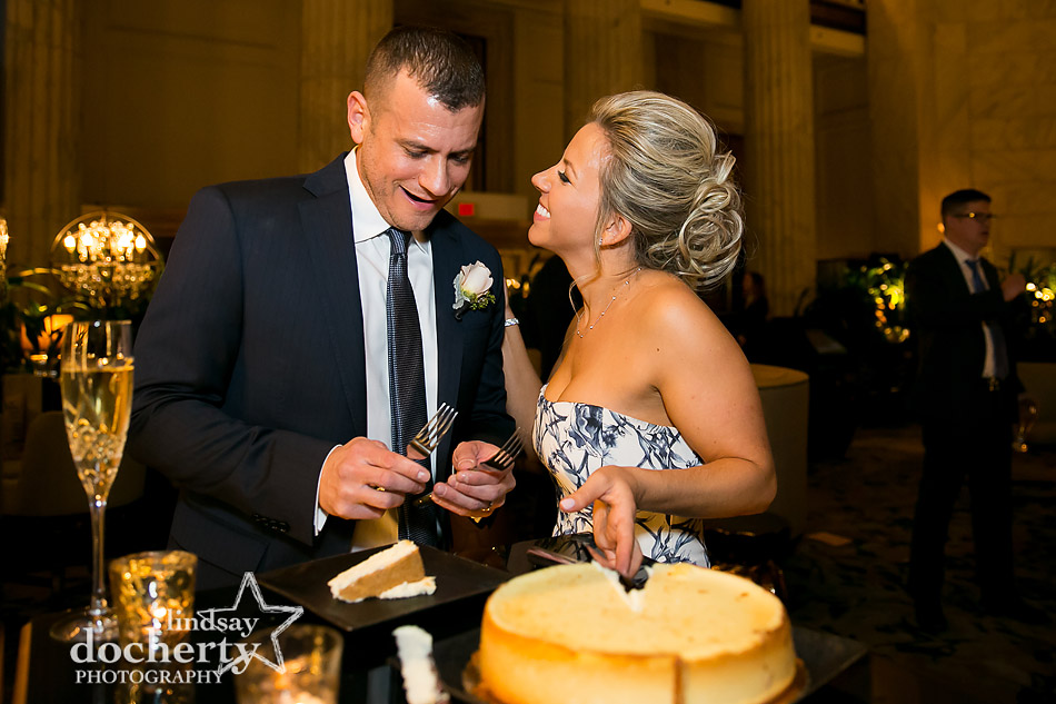 bride and groom cutting cheesecake