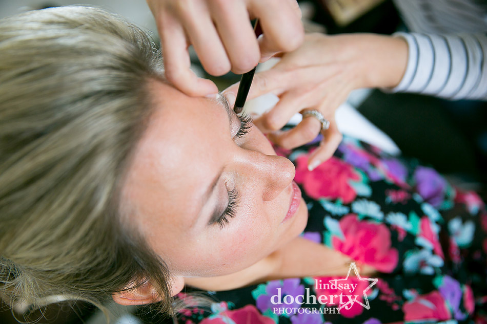 bride getting makeup done for wedding day