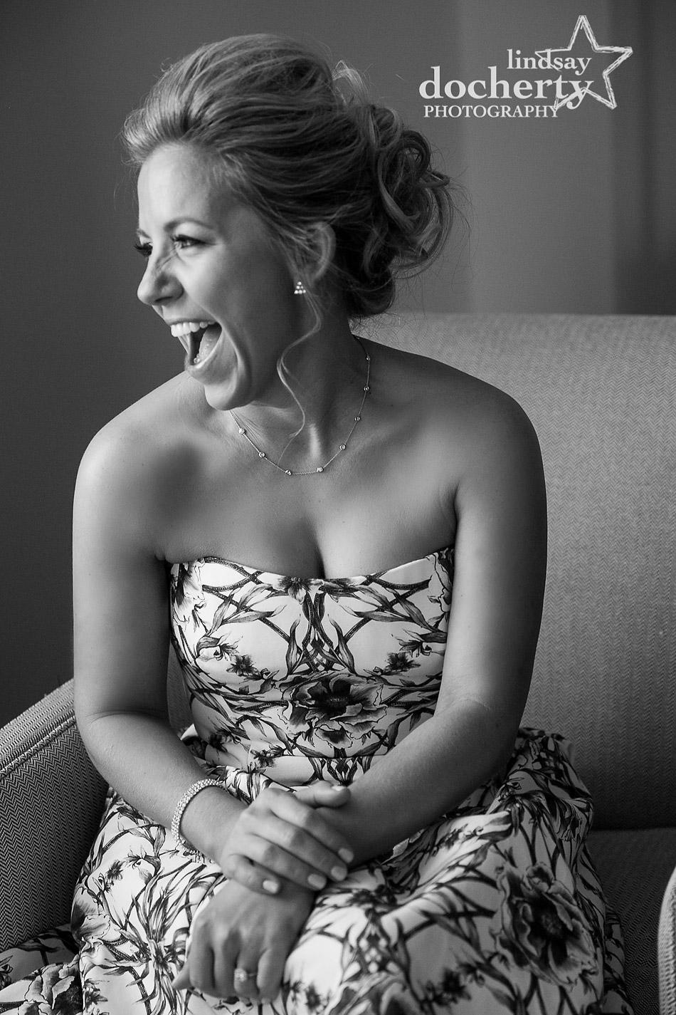 bride laughing on wedding day at Ritz Carlton