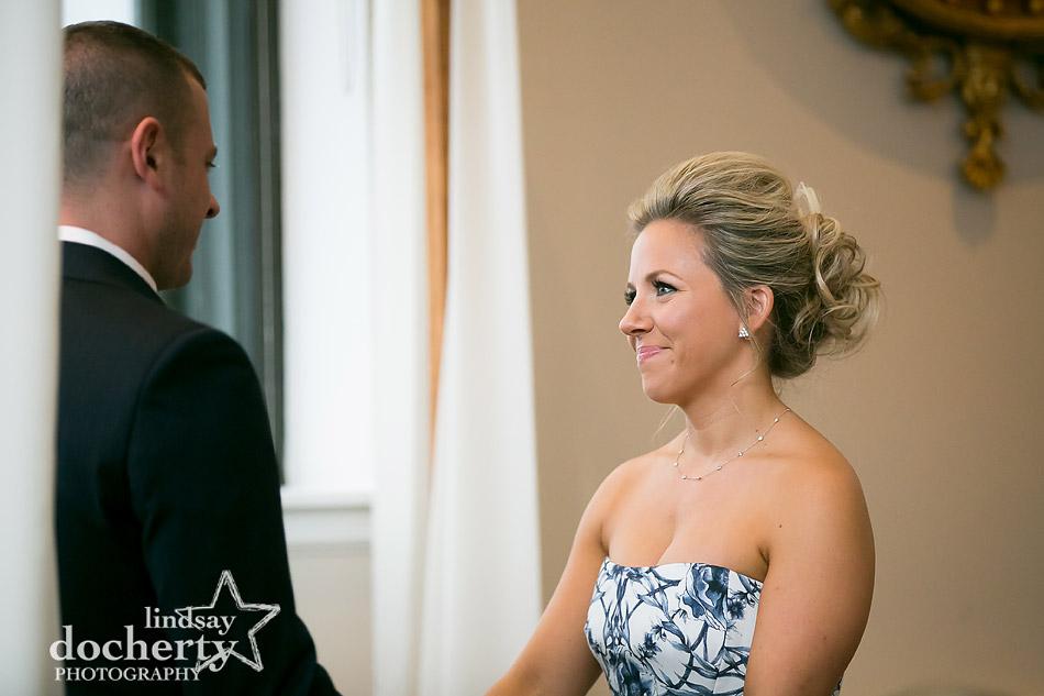 bride looking at groom during wedding ceremony at Philadelphia Ritz Carlton