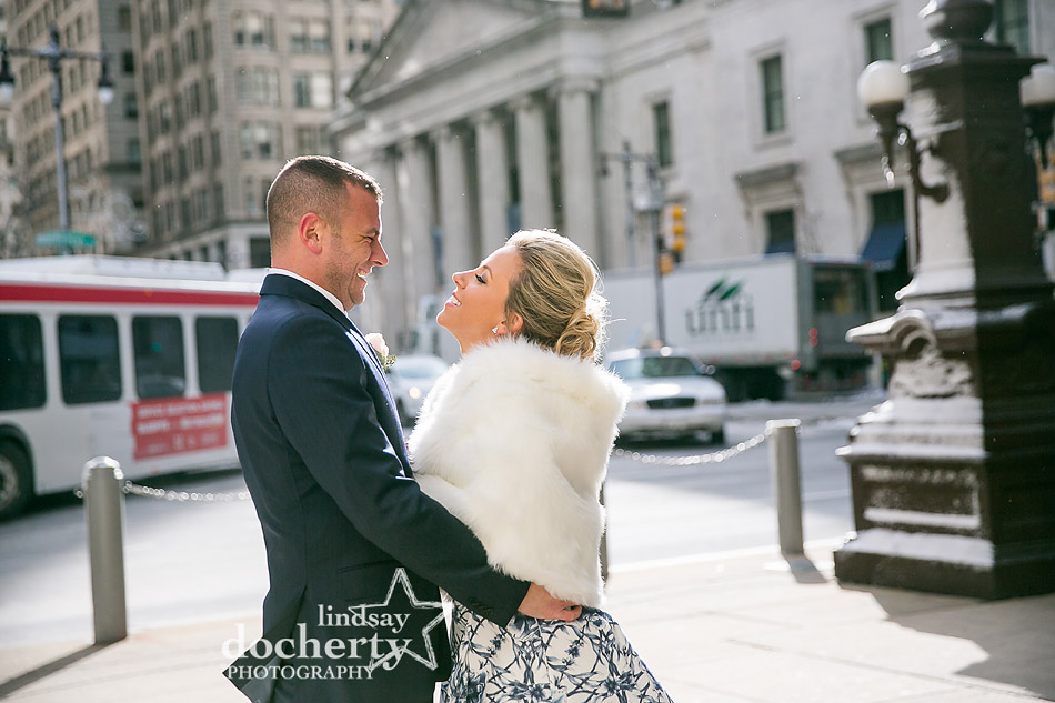 bride with fur in front of Ritz Carlton for winter wedding