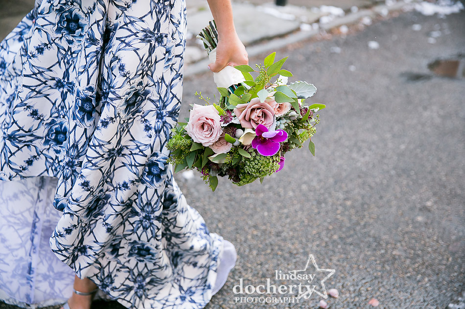 bright bouquet of flowers with blue wedding dress