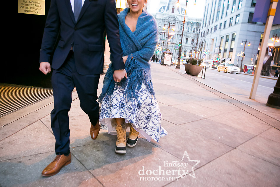 cold groom and bride in snow boots