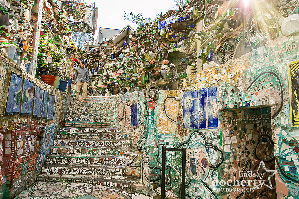 couple walking into Magic Gardens for surprise proposal