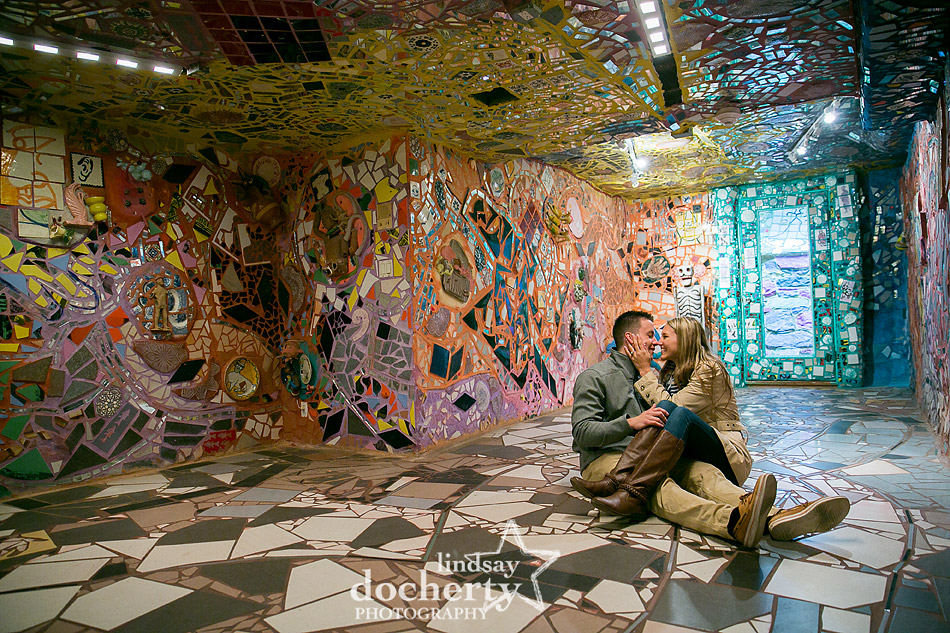 cute engagement picture inside basement of Philadelphia Magic Gardens