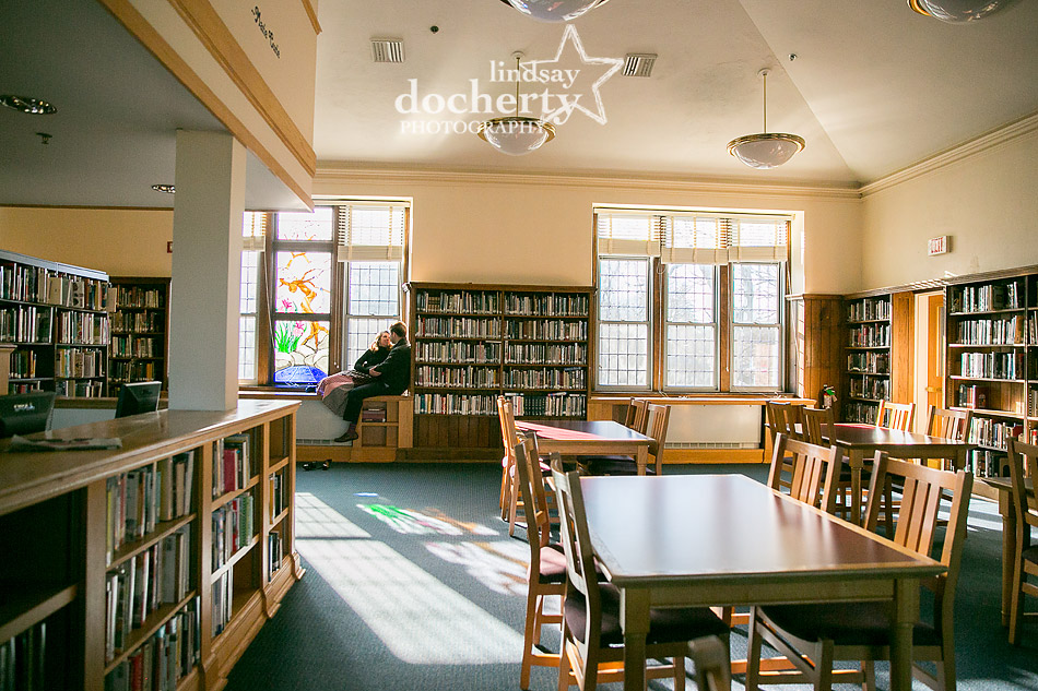 engagement session in library at Baldwin School in front of stained glass