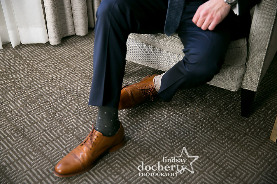 groom wearing mismatched socks for good luck on wedding day