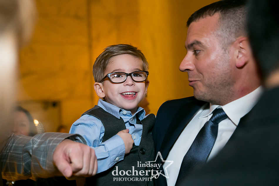 grooms cute son in glasses at cocktail hour