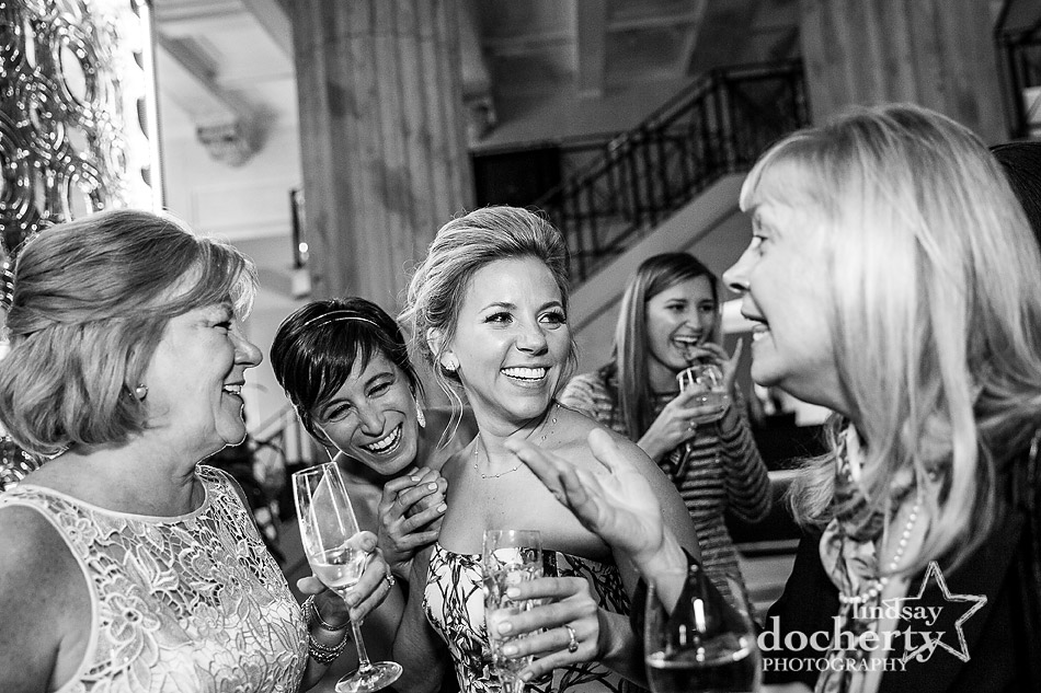 laughing with friends during cocktail hour