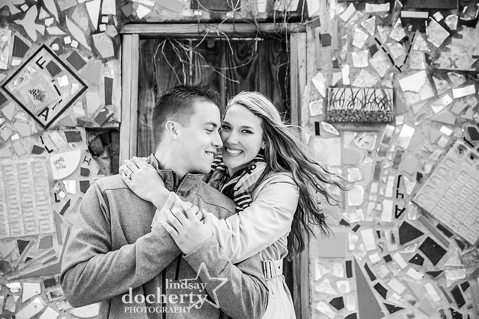 newly engaged couple in black and white against South Street mosaic