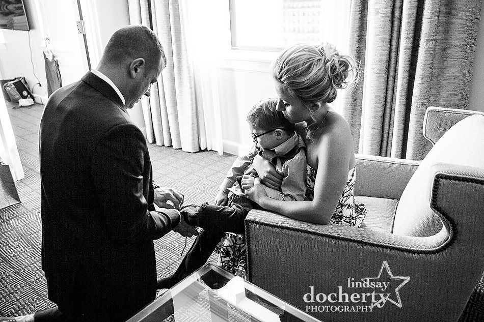 putting socks on ring bearer for Ritz Carlton wedding