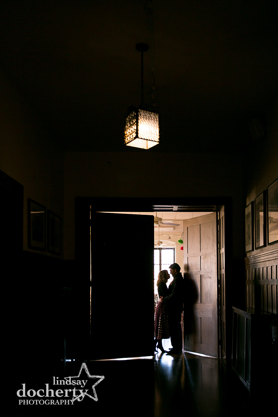 silhouette of couple in door frame at Baldwin School cafeteria