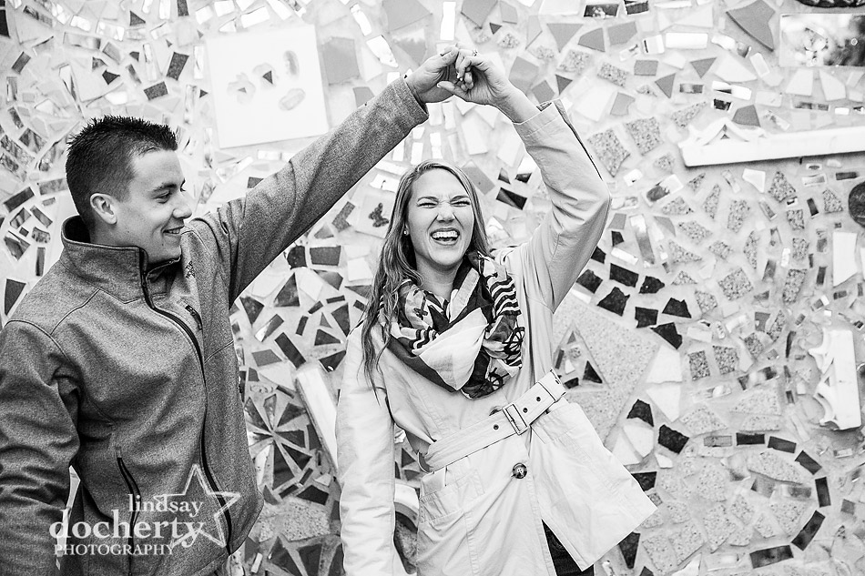 twirling around new fiancee at engagement session at Magic Gardens in Philly