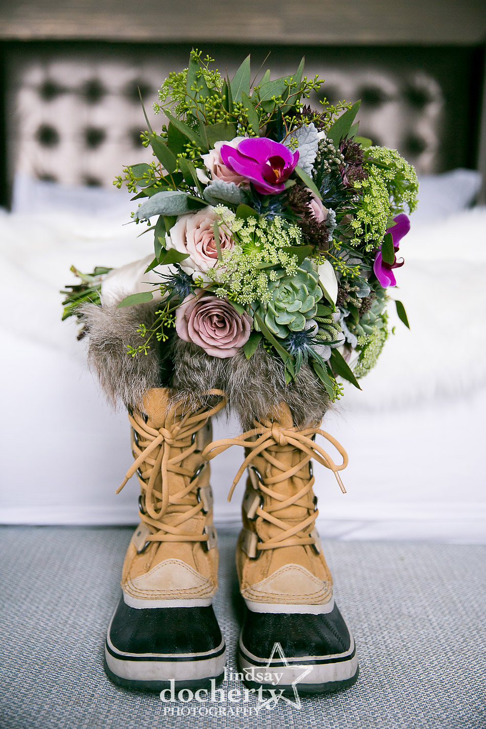 winter wedding bouquet on top of furry duck boots