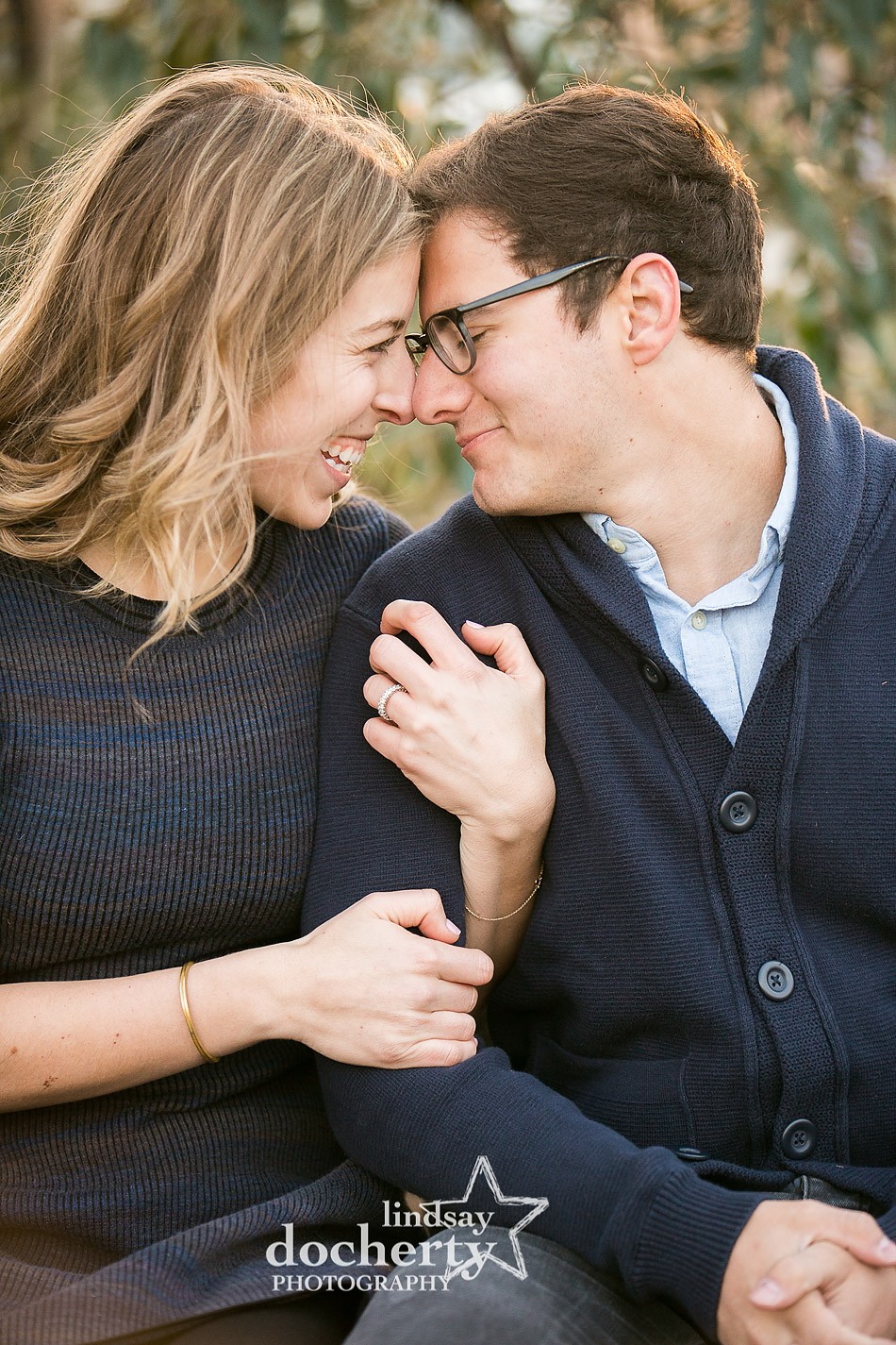 cute engagement session picture at Azalea Garden behind Philly Art Museum