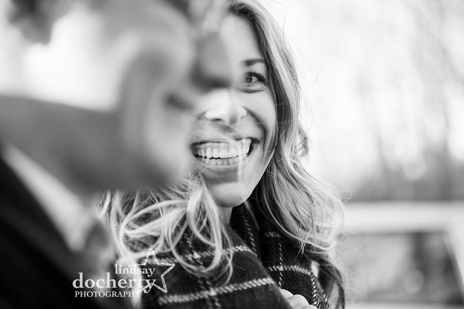 engagement picture of woman looking at fiance