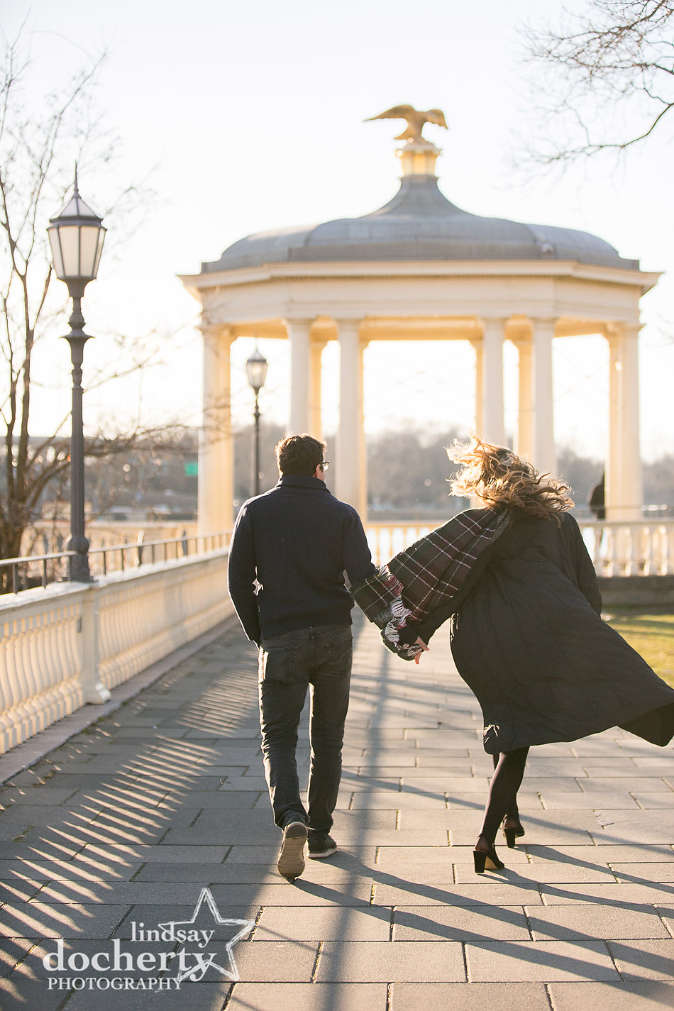 skipping at engagement session with surprise proposal in Philadelphia