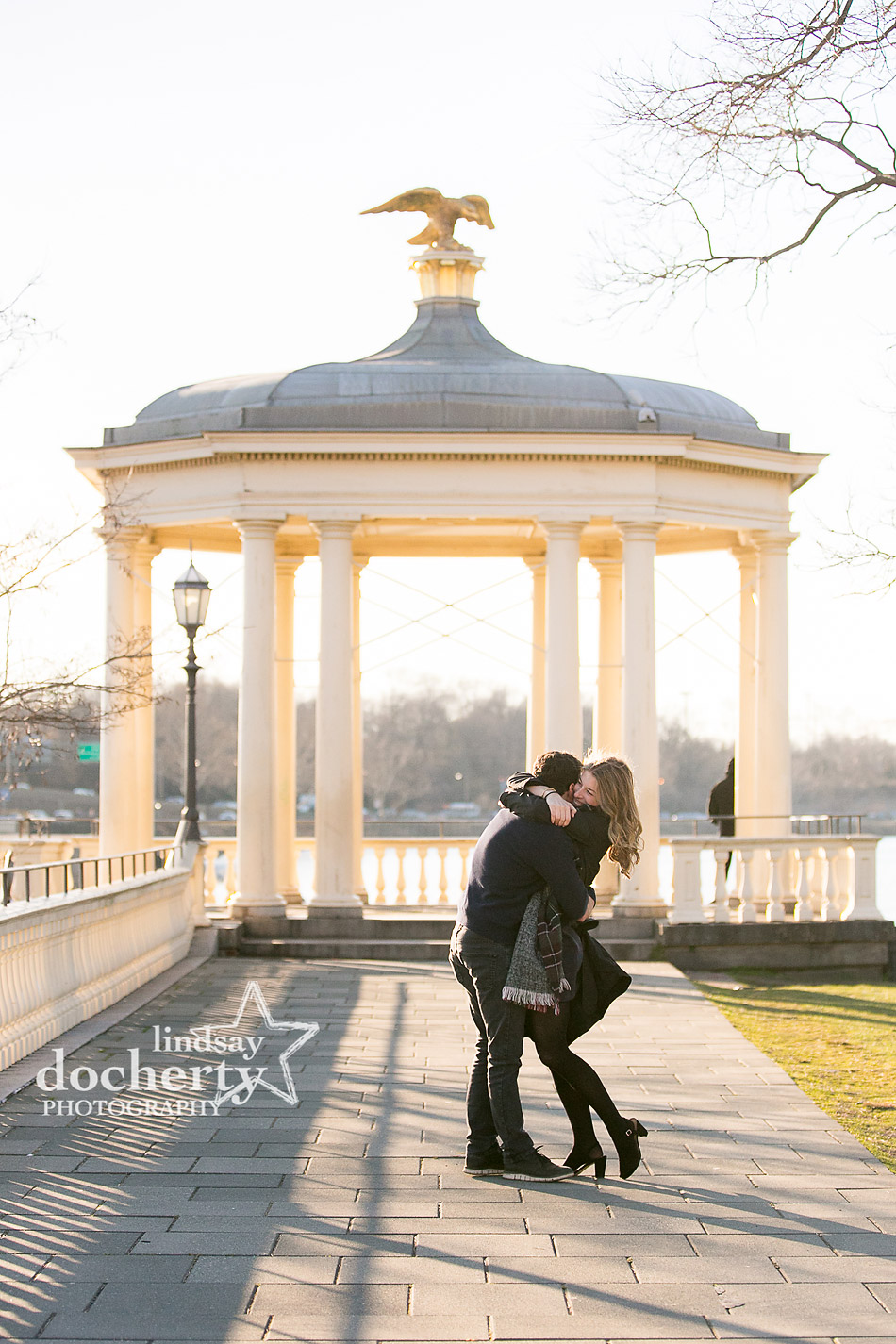 super happy kiss and dip at engagement session behind Philly Art Museum