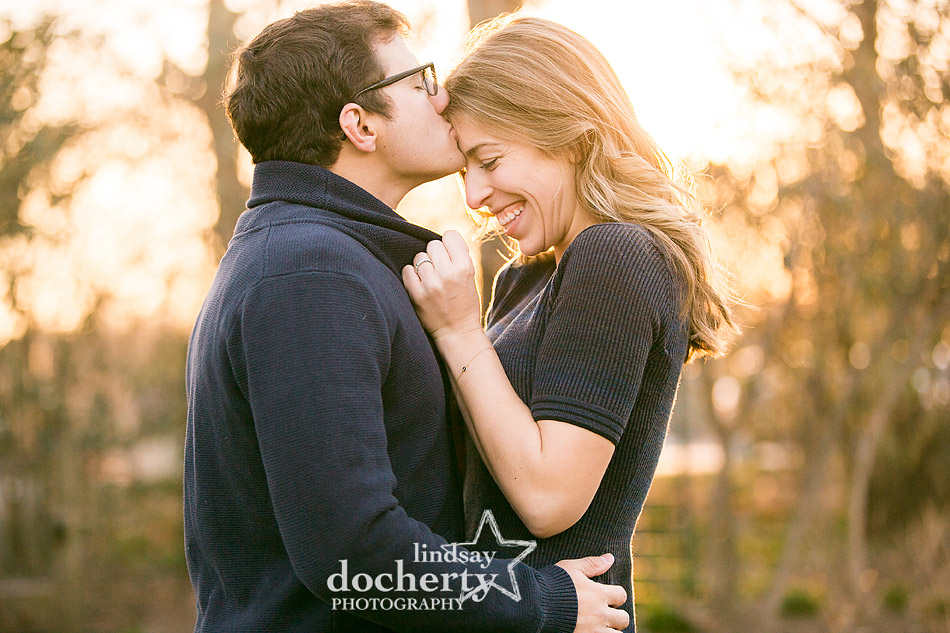 sunlit engagement picture in Philadelphia at Azalea Garden