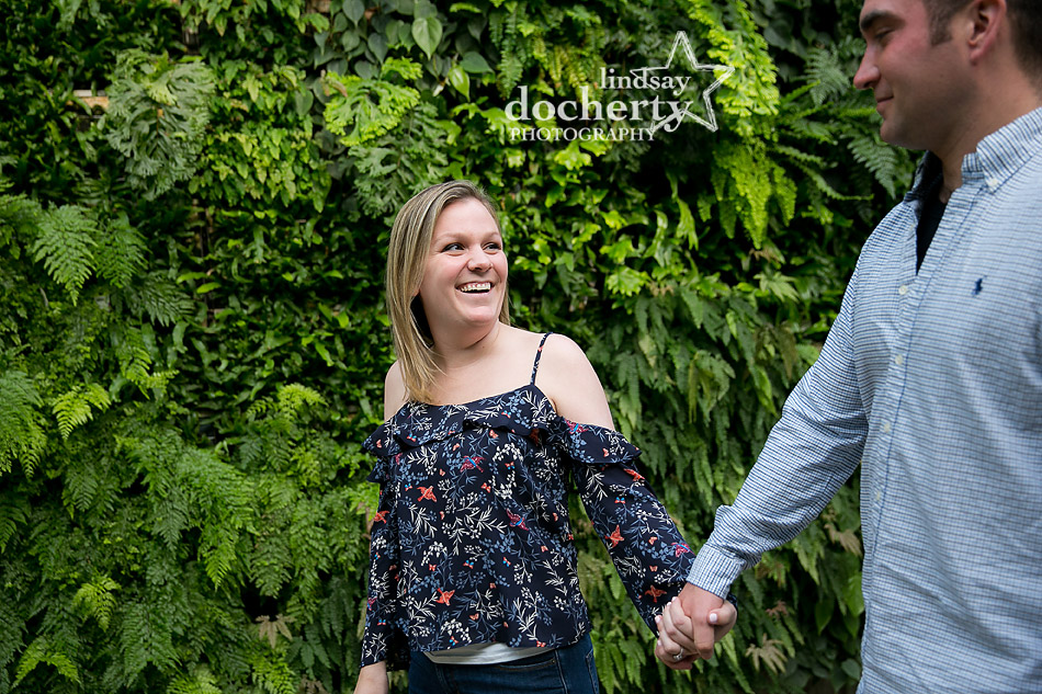 bride to be in cold shoulder top at Longwood Gardens engagement session
