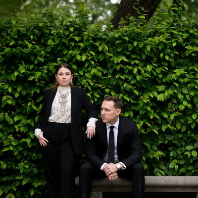 high fashion couple in pantsuit at Rodin Museum engagement session