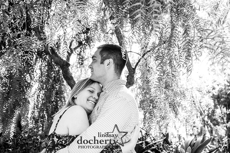 cuddly black and white engagement picture on spring day in Longwood Gardens Conservatory